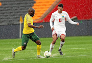 Aubrey Modiba  of Bafana and Karl Hopprich of Seychelles during  their Africa Cup of Nations qualifier   at the FNB Stadium, where Bafana won 6-0 before drawing 0-0 in the return match midweek.
