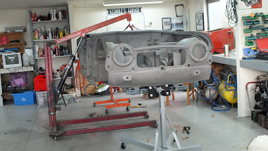 Photo: Body now media blasted and along with the chassis set up on two engine stands