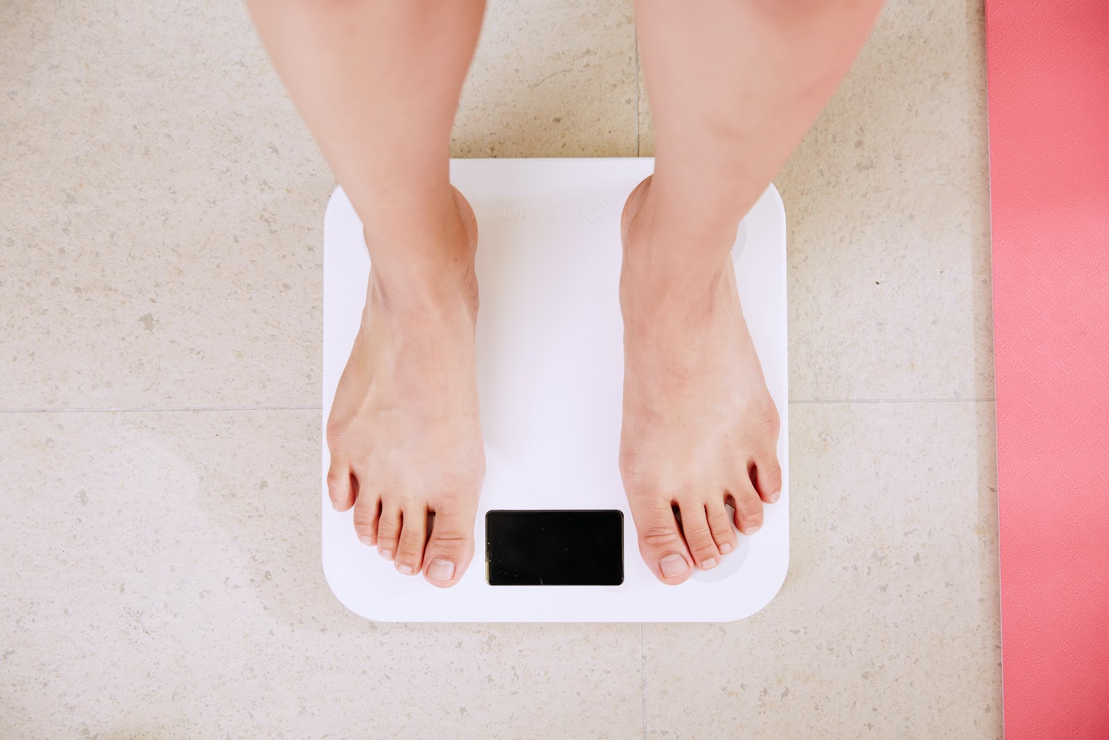 A person standing on a scale. How to lost weight.