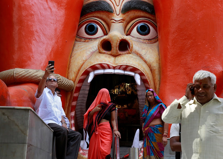 Devotees outside the temple of Hindu Lord Hanuman in New Delhi.