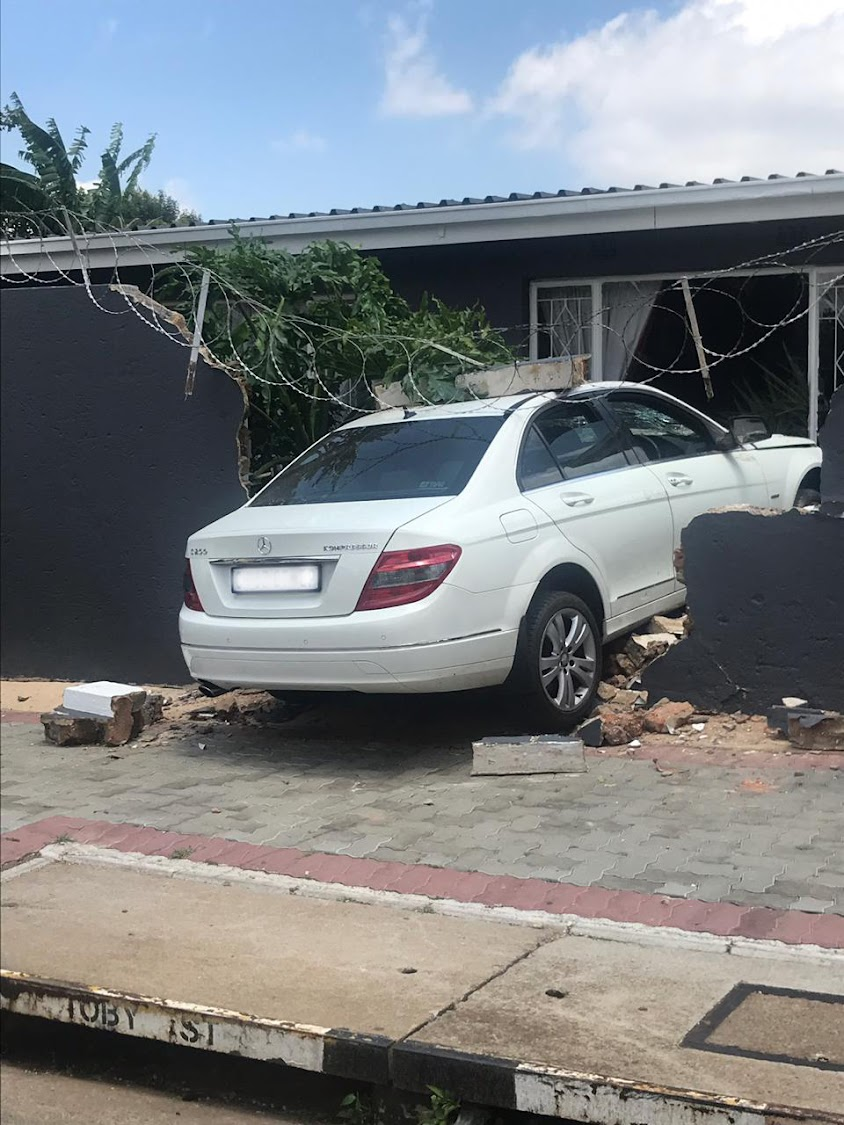 A woman was injured when a car ploughed through a wall and her lounge window in Sophiatown, Johannesburg.