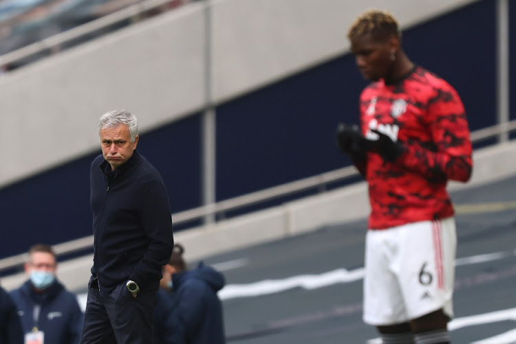 Jose Mourinho, manager of Tottenham Hotspur, reacts as Paul Pogba of Manchester United takes a moment of reflection prior to the Premier League match at Tottenham Hotspur Stadium in London on April 11, 2021.