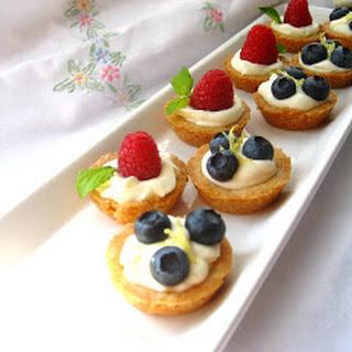 Mini Fruit Tarts...Filled with a Lemon Curd Mousse and a Shortbread crust.