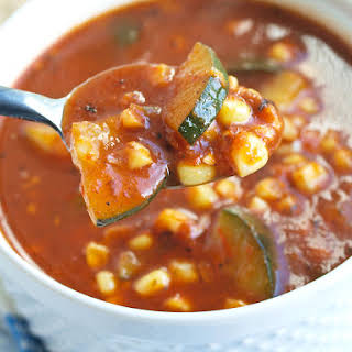 Roasted Tomato and Red Pepper Soup with Zucchini and Corn.