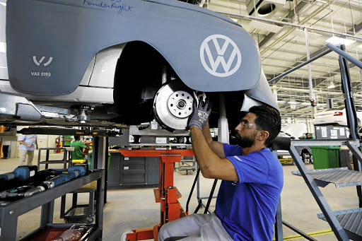 New design: A worker assembles a car at the Volkswagen car assembly unit in Relizane, Algeria. Volkswagen and Chinese ride-hailing company Didi plan to eventually collaborate to design and develop dedicated vehicles. Picture: REUTERS