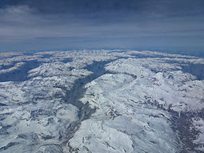 Photo: Flying over the snowed covered Alps to Italy in May, 2012.