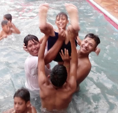 Youth playing in pool