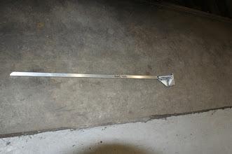Photo: Right-rear door brace/strut.