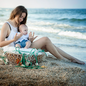 The Sea by Doru Iachim - People Family ( mother, sunset, sea, baby, young )