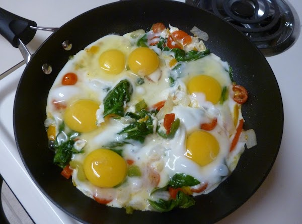 Add the eggs all around. Cook over medium heat pushing the whites between the...