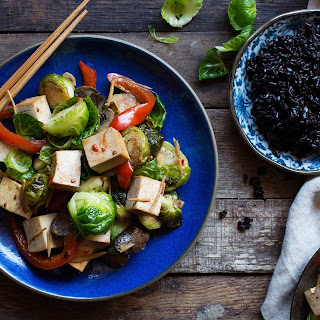 Stir-fried Brussels sprouts with tofu, mushrooms, and sweet chili sauce