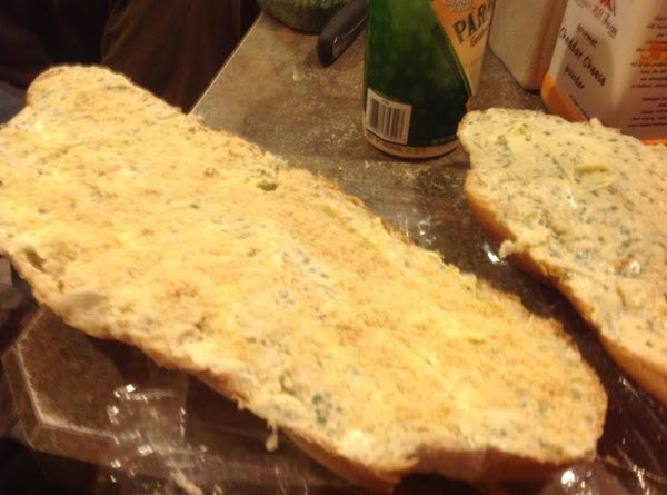 Now sprinkle 2  tablespoons of grated parmesan on each piece of bread.