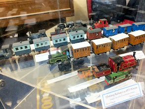 Photo: 021 Display photo 5. An interesting variety of smaller 009 locos and stock including Steve Nixon's splendid little England saddle tank loco in the foreground .