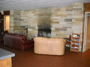 Photo: The downstairs of the clubhouse also has a fireplace.
