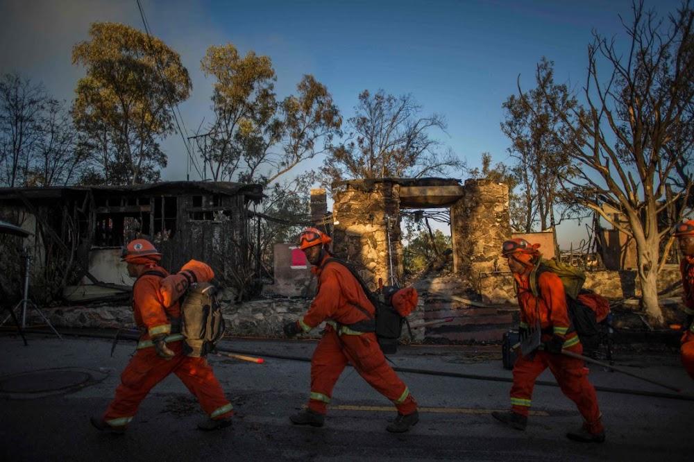 Residents flee wildfires in Los Angeles neighbourhoods