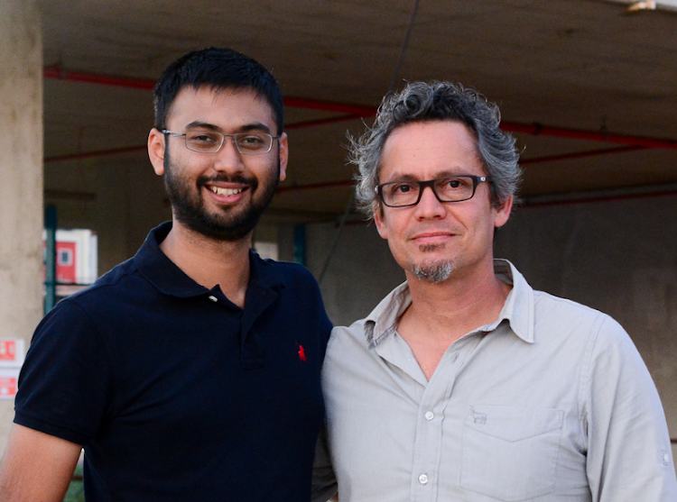 Adhir Imrith is congratulated by Lee-Zane Greyling, director at Arup Durban. Picture: SUPPLIED