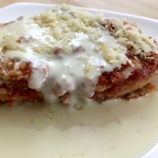 Chicken Parmigiana with White Wine Sauce.