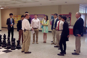 Photo: Dr. Gordon Grant, Principal of Hall Fletcher Elementary School, meets with the students from the Asheville School.