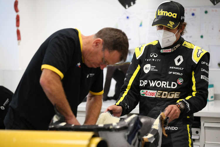 Fernando Alsono visiting the Renault F1 team's Viry-Chatillon facility ahead of testing at Barcelona on Tuesday.