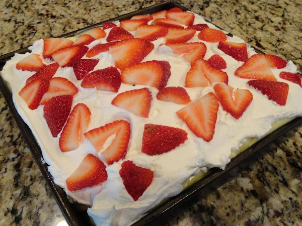 Slice up your strawberries and spread over the top. I chunk cut mine so...