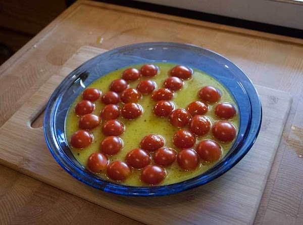 Add the liquid to the baking dish containing the tomatoes, and then add the...