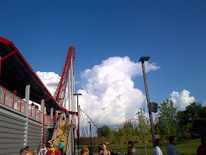 Photo: July 14, 2012 - The Intimidator Storm #creative366project curated by +Jeff Matsuya and +Takahiro Yamamoto #under5k +Creative 366 Project  Storms were building as Ethan and I waited in line to ride The Intimidator at Carowinds. A few stats on the coaster: Height 232ft (71m) Drop 211ft (64m) Length 5,316ft (1,620m) Speed 75mph (121km/h) Max vertical angle 74°