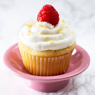Lemon Raspberry-Filled Cupcakes with White Chocolate Buttercream Frosting.