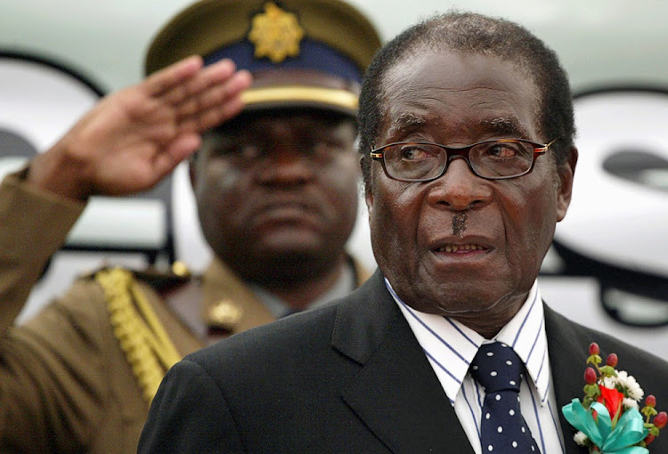 Zimbabwe President Robert Mugabe attends the launch of basic commodities in Harare, Zimbabwe July 16, 2008.