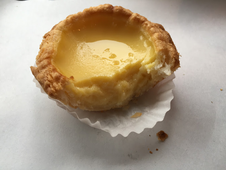 A bite from the dan tat reveals layers of crust and a consistent custard.