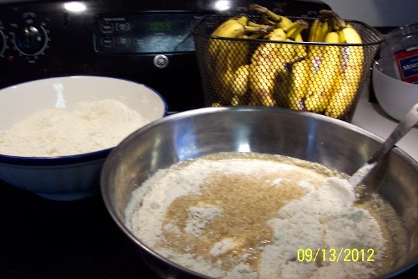Pre-heat oven to 350 degrees. Grease and flour 2 regular bread pans. In a large bowl,...