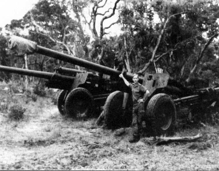 Commander of 20 SA Brigade. Colonel P. S. Fouché with two M-46 Russian artillery pieces taken by the SADF during the Operation Hooper attack on 21 Brigade.