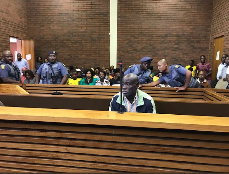 Fifita Khupe, one of the man accused of killing 7 people in Vlakfontein sitting in the dock at the Lenasia magistrate's court.