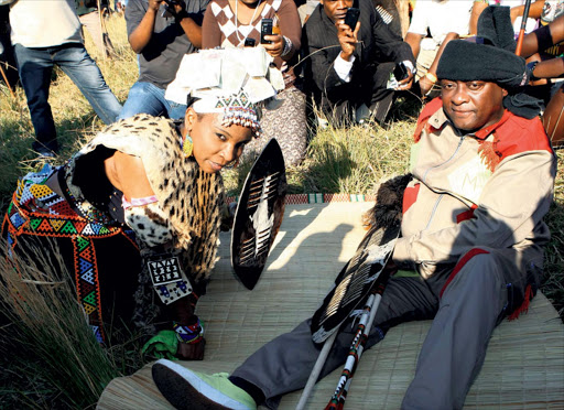 Ukhozi FM Presenter Nonhlanhla  affectionately known as Mroza  Buthelezi 's with her fiance' writer and composer Mbongeni Ngema during her traditional ceremony known as uMkhehlo at home in Dokodweni near eShowe yesterday. Pic: Thembinkosi Dwayisa