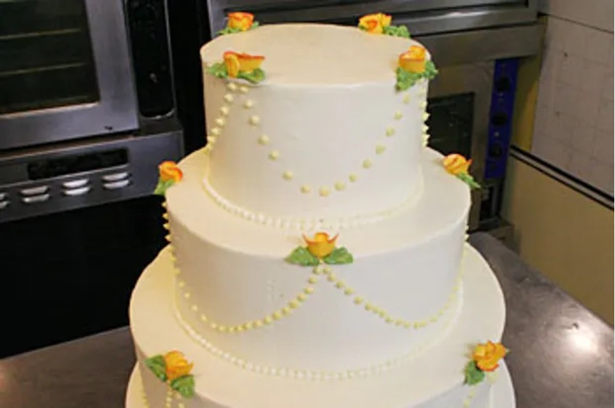 three-tiered cake with lemon and raspberry