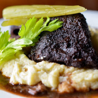 BRAISED SHORT RIBS WITH CELERY ROOT PUREE AND BRAISED CELERY.