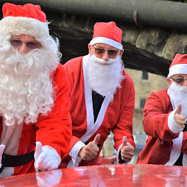 Three Santas  by Brian Stott - Public Holidays Christmas ( red suit and beard, yorkshire santa, father christmas, santa, thumbs up santa )