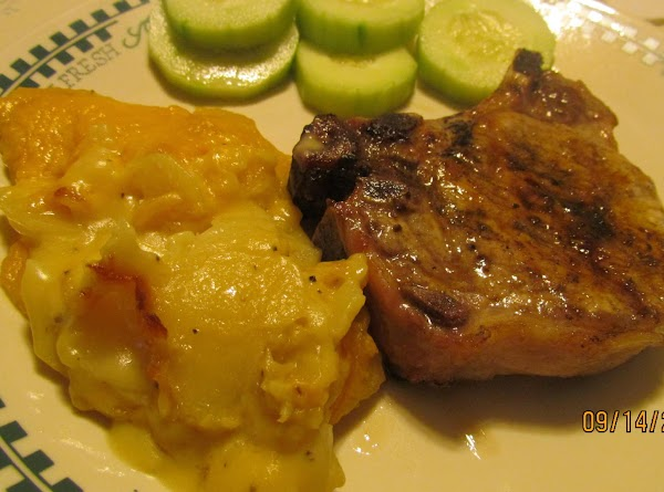 Our dinner plated up........Grilled Pork Chops, Au Gratin Potatoes and Cucumber slices.Yummy! Thanks, Dan...your...