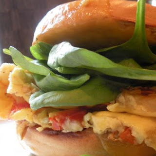 Cheddar, Spinach, and Pepper Omelet Bagel Sandwich.