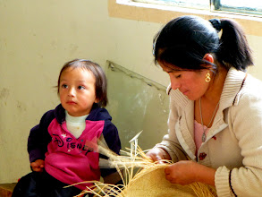 Photo: Weaving the hat by hand