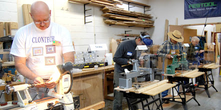 Photo: The Turning for the Troops lathes were staffed all day, turning pens to donate to the cause.