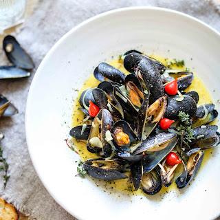 Steamed Mussels with buttery saffron sauce (Gluten free).