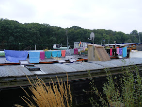 Photo: In some cases. it is in fact a little easier to tell which barges are houseboats …