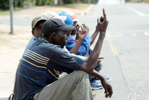 Men looking for piece jobs in Meredale, Johannesburg. Picture: KATHERINE MUICK