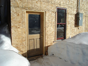 """Photo: At last in March 2010 we got a door installed on the alley side. This came from one of our projects in Telluride and is 2"""" solid oak--prior to this, no door and we had bears, coyotes, and local cats and dogs checking the shop."""