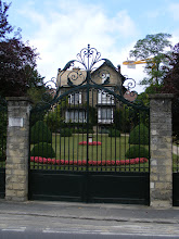 Photo: And yet another elegant gated riverside home.