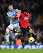 "Kyle Walker of Manchester City seen here battling for the ball against Marcus Rashford of Manchester United, is in trouble with the team after reportedly breaking coronavirus lockdown conditions by hosting a ""sex party""."