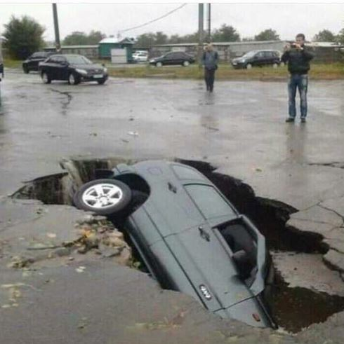 This image of a car reportedly falling into a sinkhole during the Durban storm is fake.  According to Africa Check the image originated in the Ukraine in 2014.