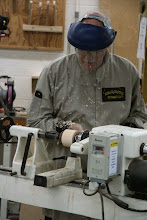 "Photo: Here Jim is turning the outside of the ""objective"" from a square lamination."