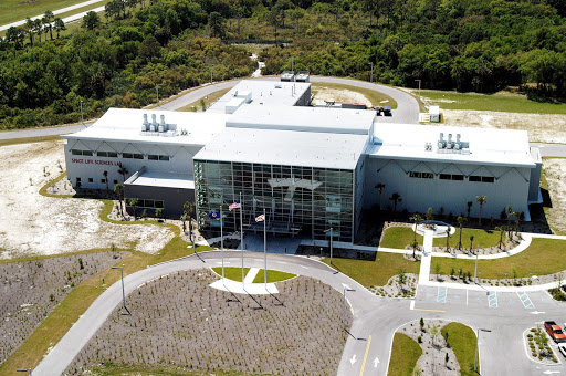 An aerial photo of the Space Life Sciences Lab at KSC.