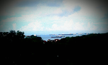 Photo: Fleecy clouds, blue waters, green treetops and ships in all hues